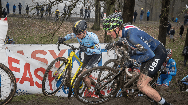Gage Hecht racing in the mud at Namur World Cup. Photo Credits to Sport.be